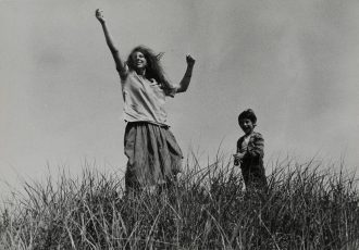 Mary and Pablo in high grass circa 1956 Robert Frank born 1924 Presented by Pierre Brahm 2008 http://www.tate.org.uk/art/work/P13074